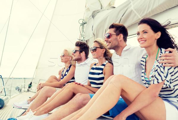 Sorridente amigos sessão iate convés férias Foto stock © dolgachov