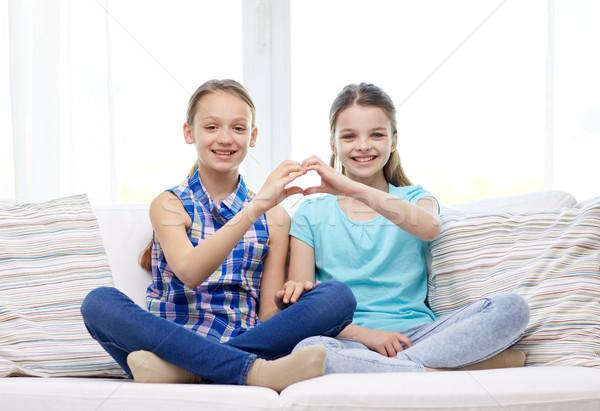 happy little girls showing heart shape hand sign Stock photo © dolgachov