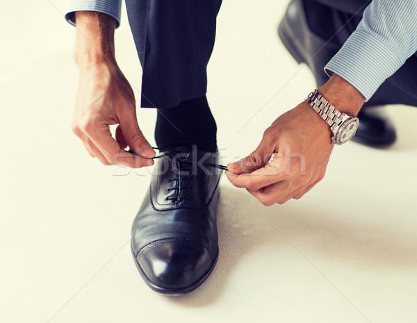 close up of man leg and hands tying shoe laces Stock photo © dolgachov