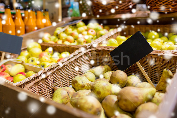 fruits in baskets with nameplates at food market Stock photo © dolgachov