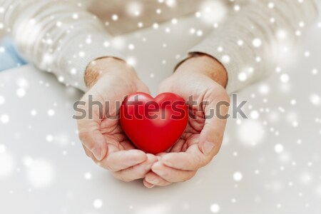 close up of male gay couple holding red hearts Stock photo © dolgachov