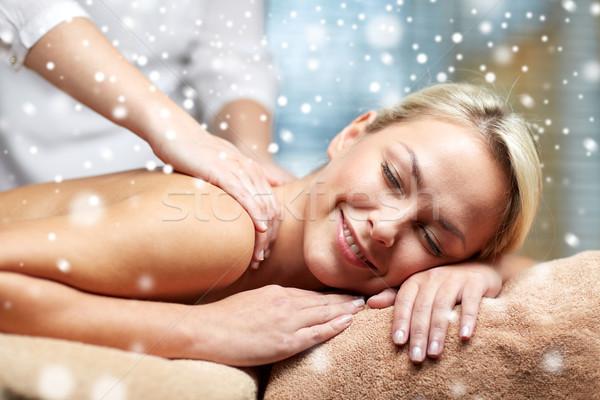 close up of woman having back massage in spa Stock photo © dolgachov