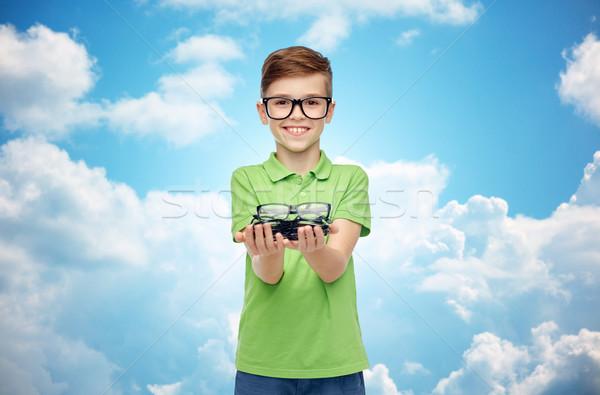 happy boy in green polo t-shirt holding eyeglasses Stock photo © dolgachov