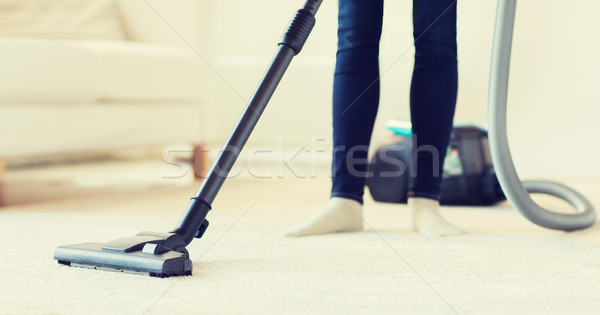 close up of woman legs with vacuum cleaner at home Stock photo © dolgachov
