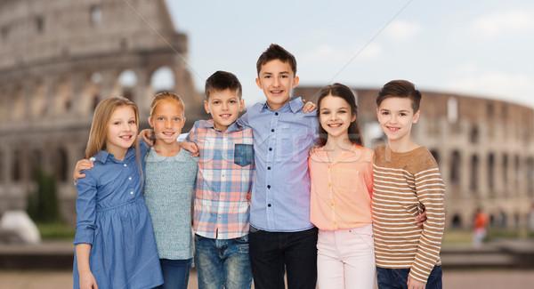 smiling children hugging over coliseum in rome Stock photo © dolgachov