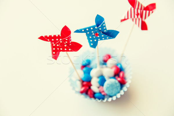 candies with pinwheel toys on independence day Stock photo © dolgachov
