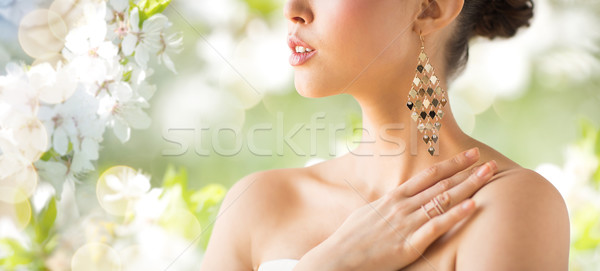 close up of beautiful woman with earrings Stock photo © dolgachov