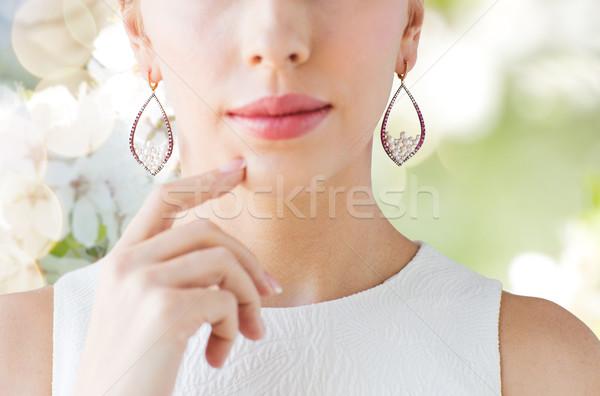 Mooie vrouw gezicht oorbellen glamour schoonheid Stockfoto © dolgachov