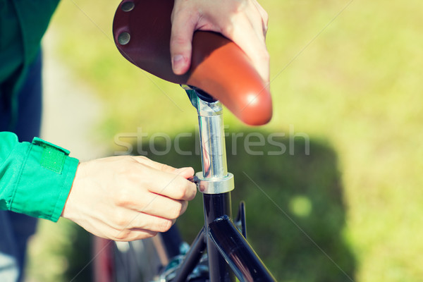 close up of man adjusting fixed gear bike saddle Stock photo © dolgachov