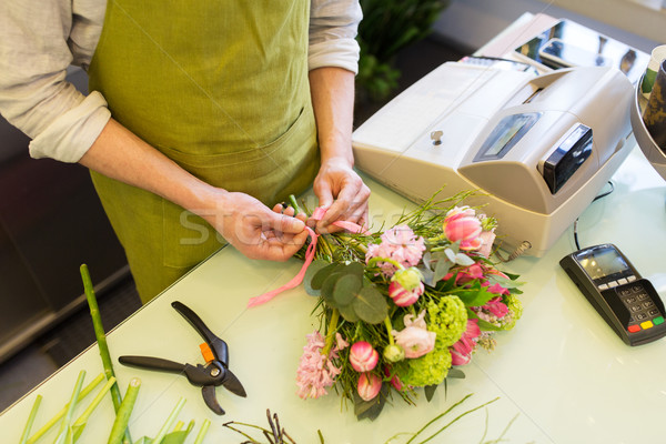 close up of florist man with bunch at flower shop Stock photo © dolgachov