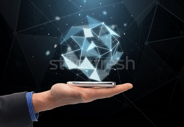 close up of hand with projection and smartphone Stock photo © dolgachov