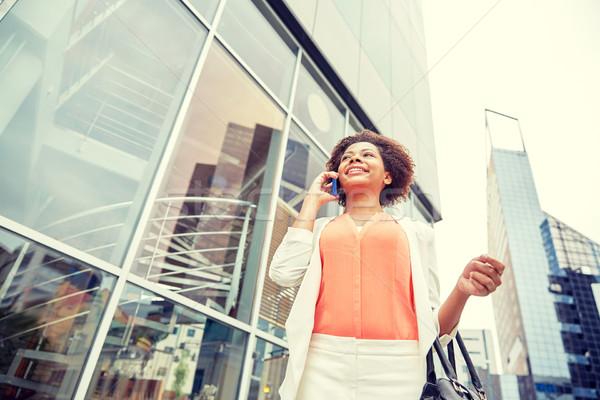 happy african businesswoman calling on smartphone Stock photo © dolgachov