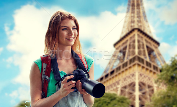 woman with backpack and camera over eiffel tower Stock photo © dolgachov