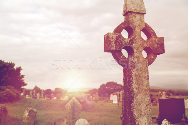 old grave cross on celtic cemetery in ireland Stock photo © dolgachov