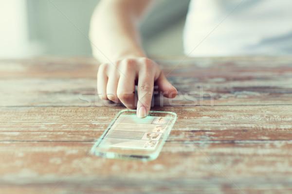 женщину прозрачный смартфон технологий Новости Сток-фото © dolgachov