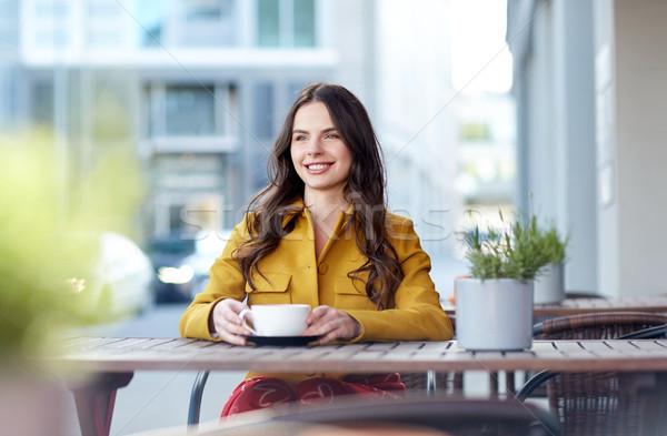 happy woman drinking cocoa at city street cafe Stock photo © dolgachov