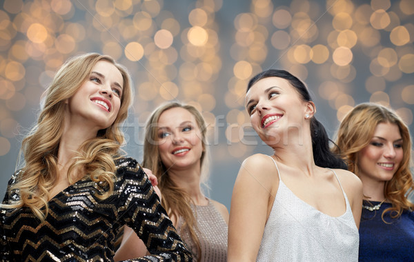 happy young women dancing at holidays party Stock photo © dolgachov
