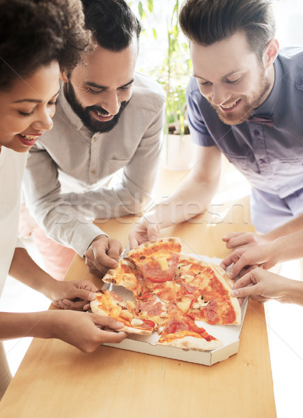 Stock photo: happy business team eating pizza in office