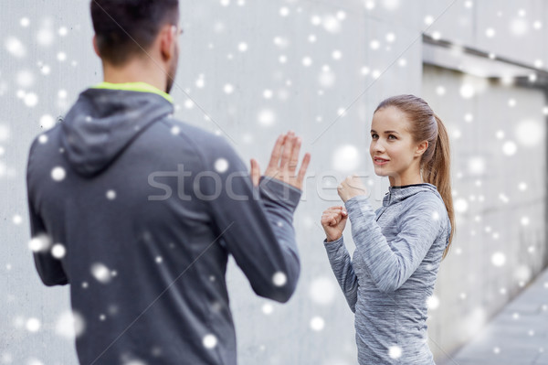 happy woman with coach working out strike outdoors Stock photo © dolgachov