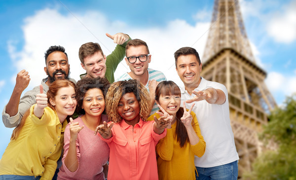 Nemzetközi csoportkép Eiffel torony utazás turizmus Stock fotó © dolgachov