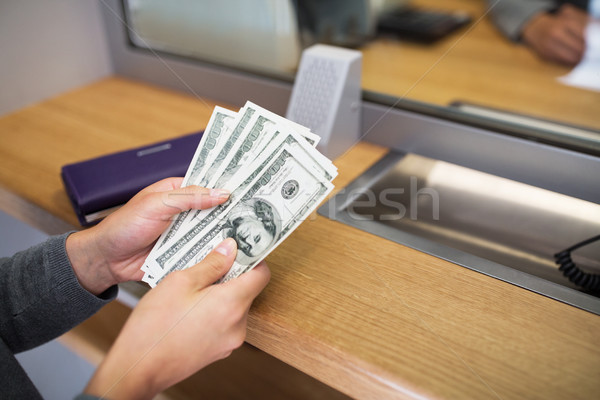 hands with money at bank or currency exchanger Stock photo © dolgachov