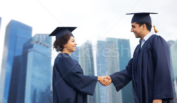 happy students or bachelors greeting each other Stock photo © dolgachov