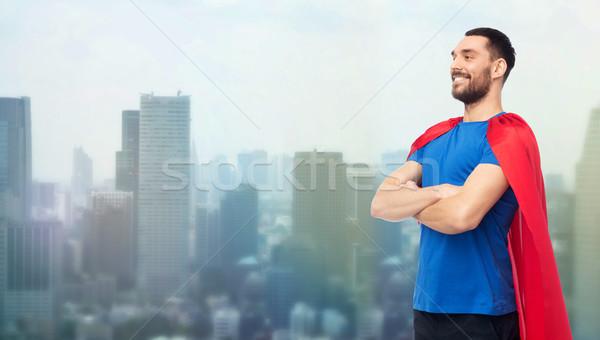 Szczęśliwy człowiek czerwony superhero miasta moc Zdjęcia stock © dolgachov