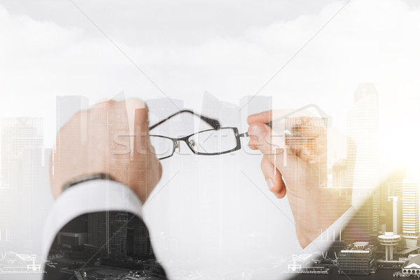 close up of businessman hands holding glasses Stock photo © dolgachov