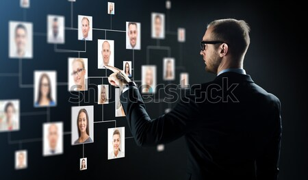 close up of businessman with transparent tablet pc Stock photo © dolgachov