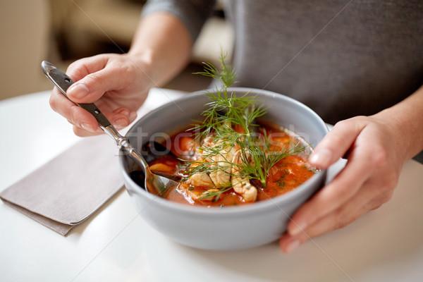 Nő eszik tengeri hal leves éttermi étel új Stock fotó © dolgachov