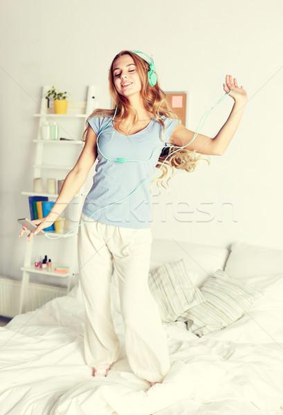 happy woman in headphones ihaving fun at home Stock photo © dolgachov