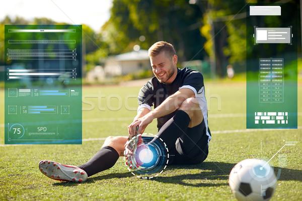 Ranny piłkarz piłka boisko do piłki nożnej sportu urazy sportowe Zdjęcia stock © dolgachov