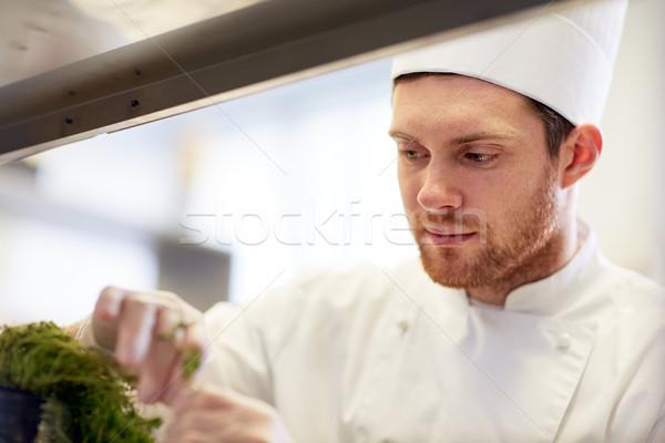 happy male chef cooking at restaurant kitchen Stock photo © dolgachov
