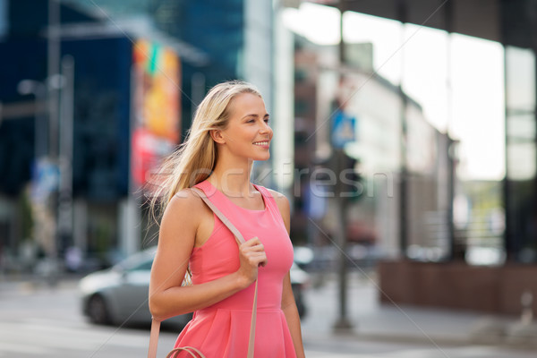happy smiling young woman on city street Stock photo © dolgachov