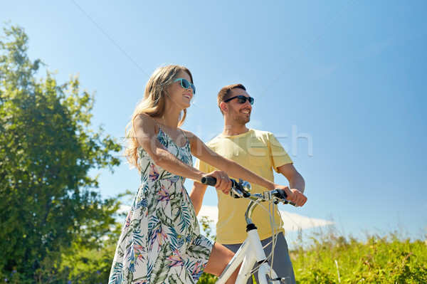 happy couple with bicycle at country Stock photo © dolgachov