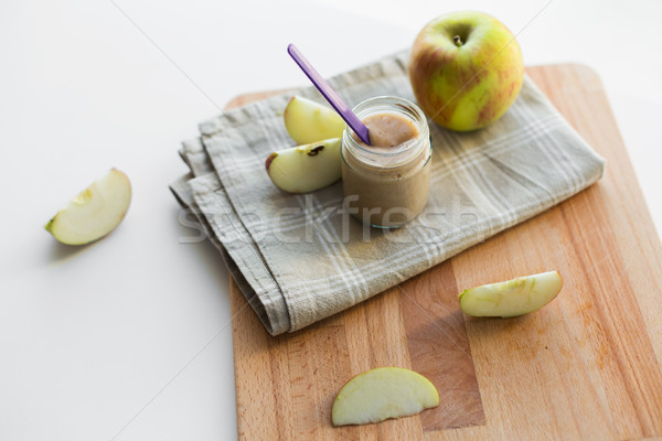 jar with apple fruit puree or baby food on table Stock photo © dolgachov