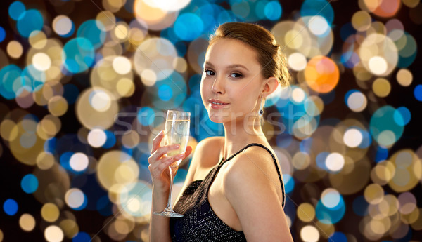 young asian woman drinking champagne at party Stock photo © dolgachov