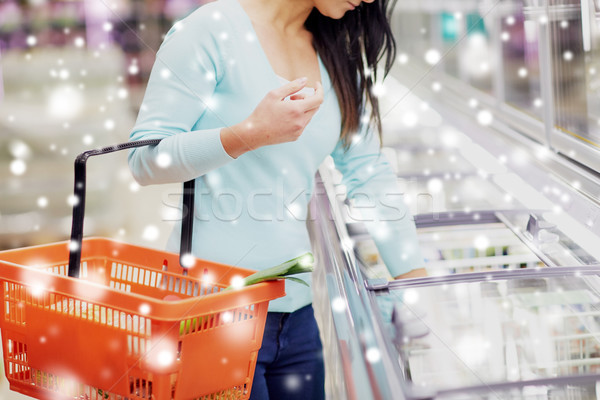 customer with food basket at grocery store freezer Stock photo © dolgachov