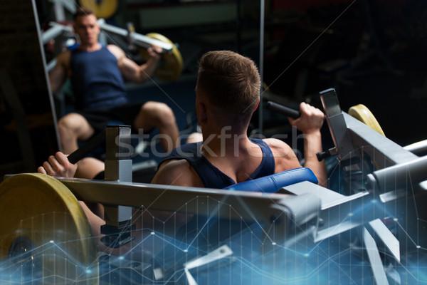 Adam göğüs basın egzersiz makine spor salonu Stok fotoğraf © dolgachov
