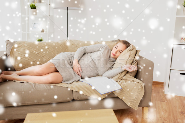 счастливым беременная женщина спальный диван домой беременности Сток-фото © dolgachov