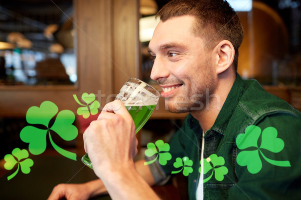close up of man drinking green beer at bar or pub Stock photo © dolgachov