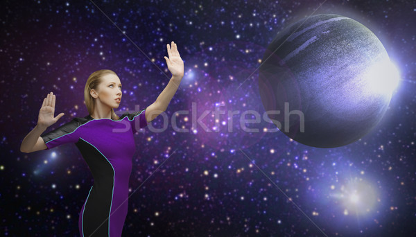 futuristic woman over planet and stars in space Stock photo © dolgachov