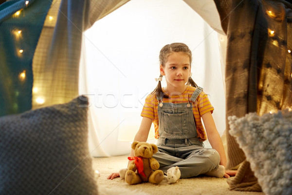 little girl with toys in kids tent at home Stock photo © dolgachov