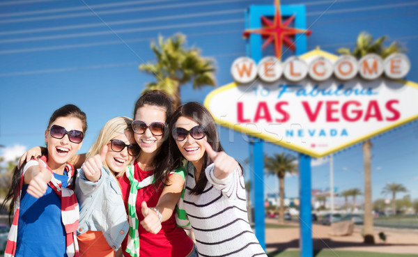 group of happy women or friends at las vegas Stock photo © dolgachov