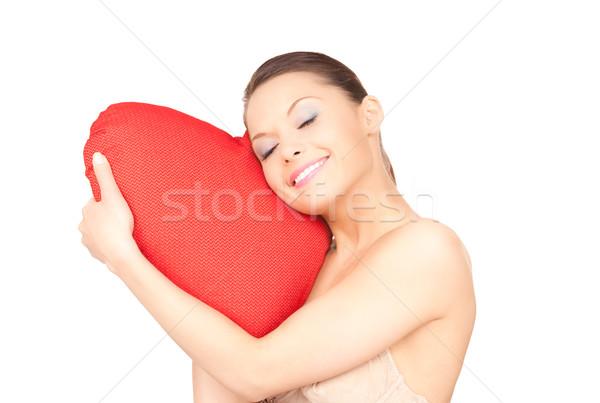 Kadın kırmızı yastık beyaz mutlu model Stok fotoğraf © dolgachov