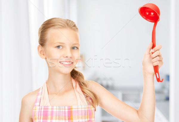 Pequeño ama de casa rojo cucharón cocina Foto Foto stock © dolgachov