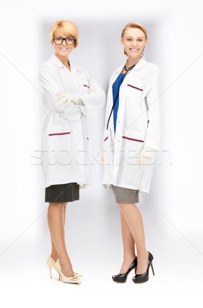 Привлекательная женщина врачи ярко фотография два врач Сток-фото © dolgachov