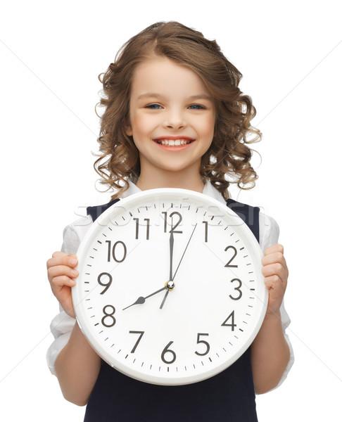girl with big clock Stock photo © dolgachov