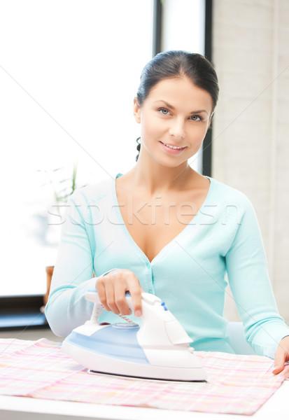 housewife ironing clothes Stock photo © dolgachov