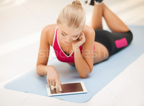 woman lying on the floor with tablet pc Stock photo © dolgachov